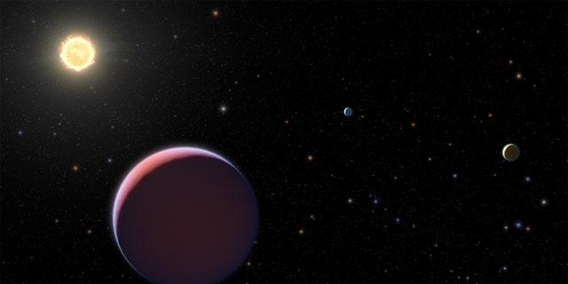 An artist's depiction of the Kepler 51 star system. (Credit: NASA/ESA/STScI)
