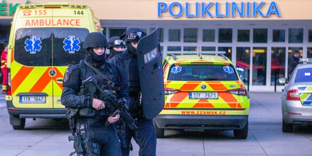 Police personnel outside the Ostrava Teaching Hospital after a shooting incident in Ostrava, Czech Republic, Tuesday, Dec. 10, 2019.