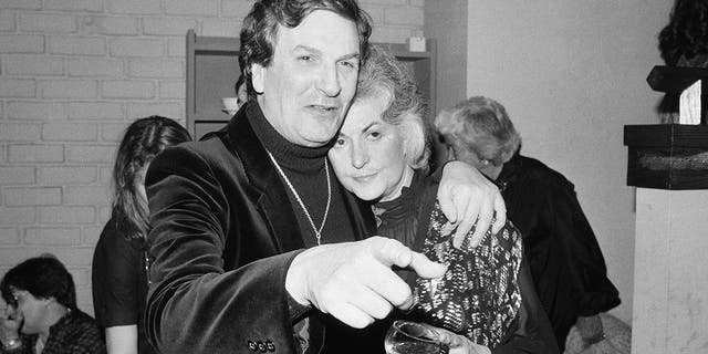 In this April 28, 1981 file photo, Actor Danny Aiello hugs actress Beatrice Arthur at a party following their opening performance in Woody Allen's play,