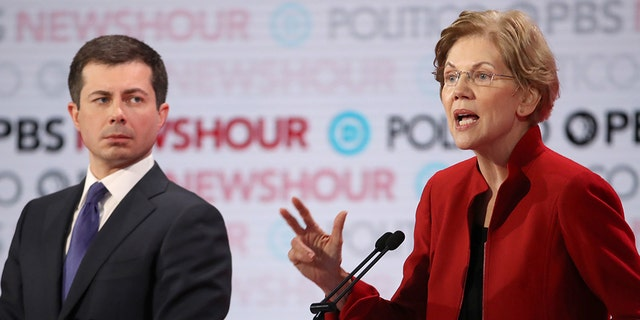 Sen. Elizabeth Warren (D-MA) speaks as former South Bend, Ind., Mayor Pete Buttigieg listens during the Democratic presidential primary debate at Loyola Marymount University on Dec. 19, 2019 in Los Angeles, Calif.