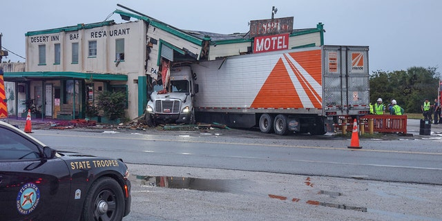 A tractor trailer slammed into the historic Desert Inn and Restaurant in Yeehaw Junction, Fla., early Sunday, according to a report.