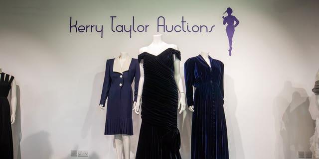 Princess Diana's iconic 'Travolta Dress' (center) at Kerry Taylor Auctions.