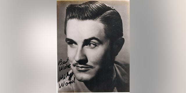 A photo of Ed Wood signed by Kathy Wood.