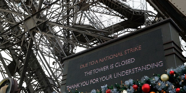 A screen announces the closure of the Eiffel Tower on Tuesday. (AP)