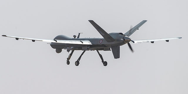 This photo provided by the French Defense Ministry communication center shows a French Reaper drone with two GBU 12 missiles flying over Niamey airbase, Niger, on Dec. 17. (AP/EMA/DICOD)