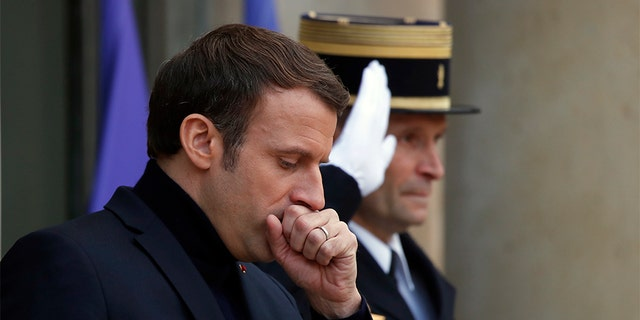 French President Emmanuel Macron is under pressure as protests continue against his proposed pension reform plans. (AP)