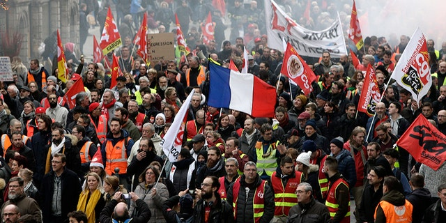 Protestors march in Lille, northern France, on Tuesday. Teachers, doctors, lawyers and workers at the Eiffel Tower were among those who walked off the job to resist a higher retirement age, or to preserve a welfare system they fear their president wants to dismantle.