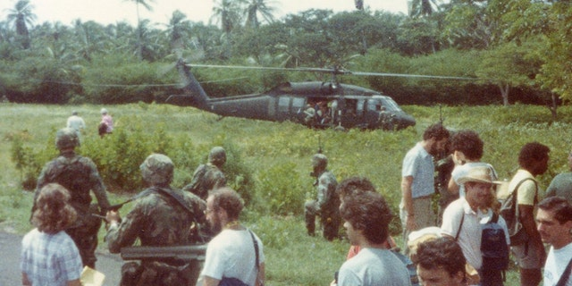 U.S. forces evacuating American students from Grenada in 1983