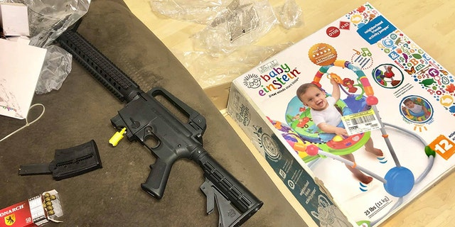 Veronica Alvarez-Rodriguez says this Mossberg 715T semiautomatic rifle was discovered inside a box that was labeled a baby bouncer.