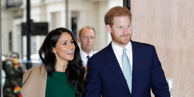 Prince Harry and Meghan Markle will officially no longer hold the titles of Duke and Duchess of Sussex, Buckingham Palace confirmed on Saturday.