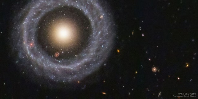 With a perfectly symmetrical ring circling a red sphere of stars, Hoag's object is one of the prettiest mysteries in the universe. (Credit: NASA/ESA/Hubble)