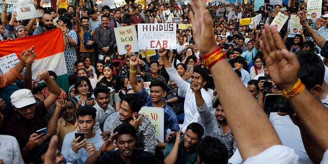 Indians protest against a new citizenship law in Mumbai, India, Monday, Dec. 16, 2019. The new law gives citizenship to non-Muslims who entered India illegally to flee religious persecution in several neighboring countries.