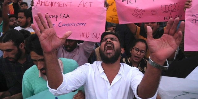 Indian Hyderabad Central University (HCU) students shout slogans during a protest rally against a new citizenship law in Hyderabad, India, Monday, Dec.16, 2019. The new law gives citizenship to non-Muslims who entered India illegally to flee religious persecution in several neighboring countries. (AP Photo/Mahesh Kumar A.)