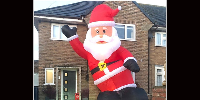 """""""When I woke up in the morning, I looked out and his head would eclipse the window,"""" the man said. """"Downstairs in the front room, when you opened the curtains, there was a big Santa bum in your face."""""""