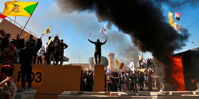 Protesters burn property in front of the U.S. embassy compound. [AP)