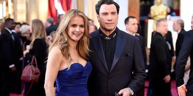 Kelly Preston and John Travolta arrive at the Oscars on Sunday, Feb. 22, 2015, at the Dolby Theatre in Los Angeles.