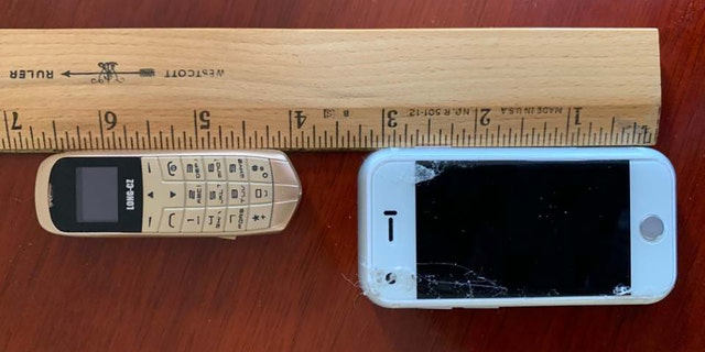 The tiny cellphones discovered hidden underneath the insoles of the shoes all measured about 3 inches long.