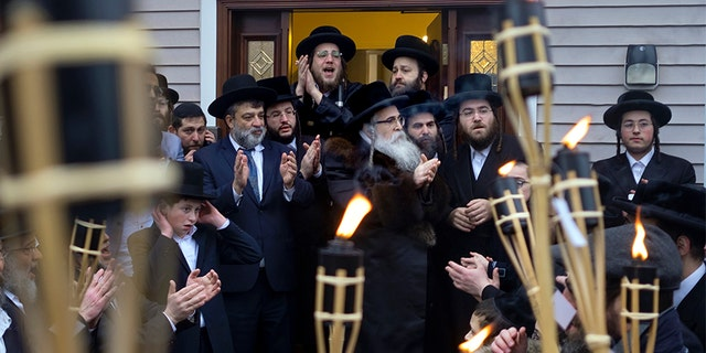 Community members celebrating the arrival of a new Torah at Chaim Rottenberg's home Sunday in Monsey, N.Y. (AP)