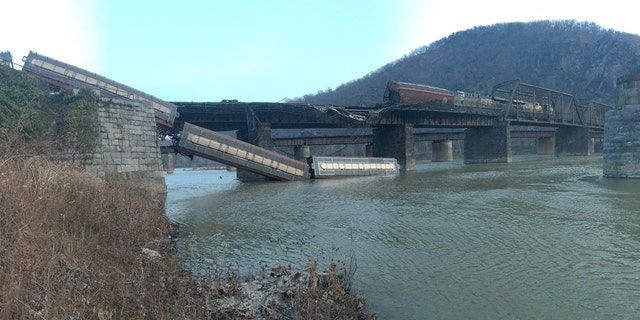 A CSX freight train derailed near Harpers Ferry, W. Va., sending two cars tumbling into the Potomac River.