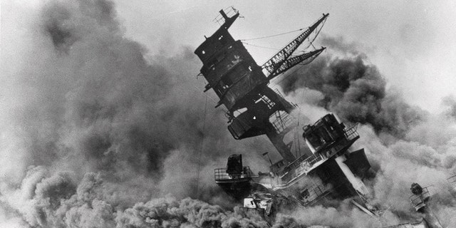 Smoke rises from the battleship USS Arizona as it sinks during the Japanese attack on Pearl Harbor, Hawaii, Dec. 7, 1941. (Associated Press)