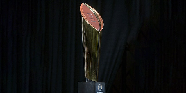 Jan 8, 2019; San Jose, CA, USA; Detailed view of the 2019 College Football Playoff championship trophy at a press conference at the San Jose McEnery Convention Center. Clemson defeated Alabama 44-16 to win its second national title in three years. Mandatory Credit: Kirby Lee-USA TODAY Sports - 11961694
