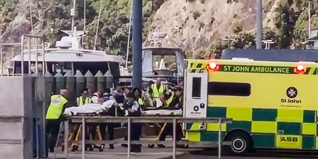 In this image made from video, injured from White Island volcanic eruption are ferried into waiting ambulances in Whakatane, New Zealand, Monday, Dec. 9, 2019. (Katee Shanls/NZME via AP)