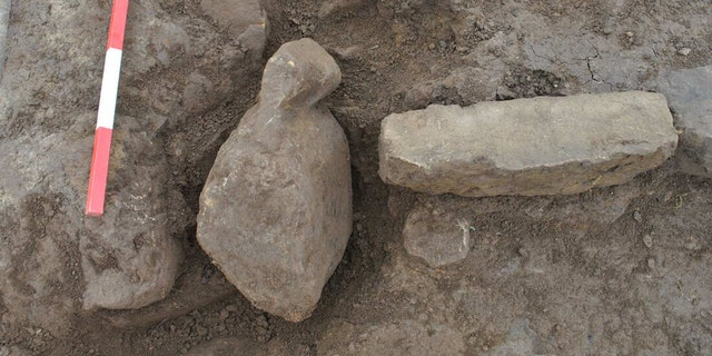 One of the figurines in situ next to the hearth. Finstown. (Credit: ORCA Archaeology)