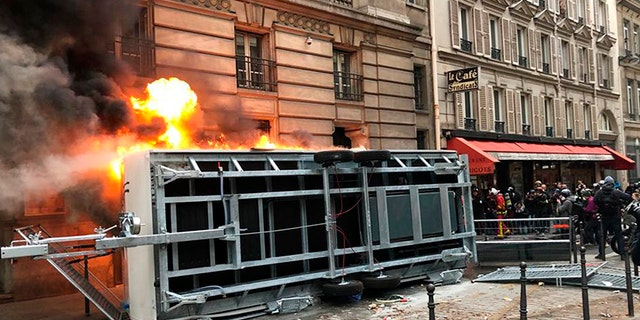 A truck is set ablaze during a demonstration in Paris on Thursday.