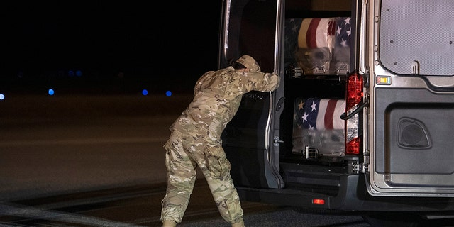 Air Force Door Attendant Staff Sgt. Siannie Conception closes the door of the transfer vehicle carrying the transfer cases containing the remains of Ensign Cameron Joshua Kaleb Watson, Seaman Mohammed Sameh Haitham, and Seaman Apprentice Cameron Scott Walters, Sunday, Dec. 8, 2019, at Dover Air Force Base, Del. A Saudi gunman killed the three people in a shooting at Naval Air Station Pensacola in Florida. (AP Photo/Cliff Owen)
