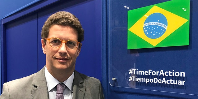 In this photo taken on Saturday, Brazilian environment Ricardo Salles stands outside the Brazil delegation room at the COP25 U.N. climate talks in Madrid, Spain.