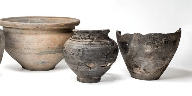 The remains of a Roman mirror and pots were also discovered. (Credit: SWNS)