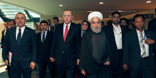 Turkey's President Recep Tayyip Erdogan, centre left, was among other world leaders present at the Islamic conference on Thursday. Erdogan and Rouhani had a meeting on the sidelines of the conference. (Presidential Press Service via AP, Pool)