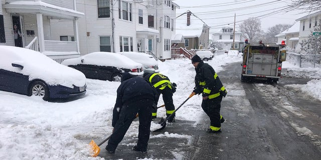 Firefighters helped shovel the man's driveway after freeing him from his snowblower.