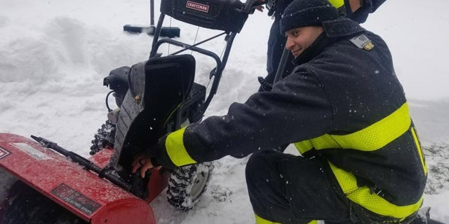 Fire officials had to rescue a man who got his hand stuck in a snowblower on Tuesday morning. The firefighters then helped put the man's snowblower back together.
