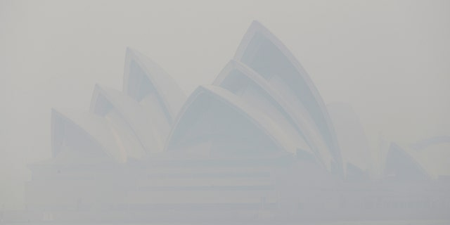 Thick smoke from wildfires shroud the Opera House in Sydney, Australia, Tuesday, Dec. 10, 2019.