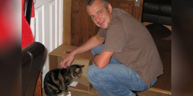 John Kinloch with his pet cat Tabs the cat before he went missing.