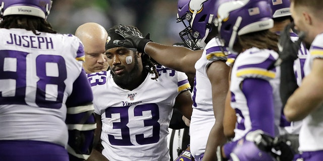 Minnesota Vikings's Dalvin Cook (33) heads off the field after being injured during the second half of an NFL football game against the Seattle Seahawks, Monday, Dec. 2, 2019, in Seattle.