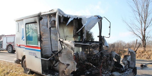 A U.S.Postal Service went up in flames Sunday in Kansas. A postal worker saved several packages slated for delivery.
