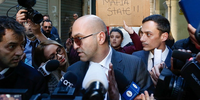 Fenech faced questions from the media after he left court Friday. (AP Photo/str)