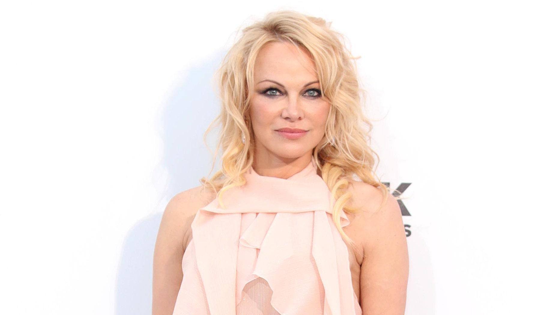 Pamela Anderson marries her bodyguard in intimate Christmas wedding