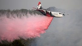 Australian wildfire sparked by helicopter fighting blazes threatens homes on Canberra outskirts