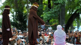 Female flogging force unveiled in Indonesia to publicly punish women who violate Sharia law