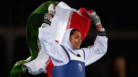 Kimia Alizadeh, Iran's lone female Olympic medalist, moves to Germany after defecting, coach says