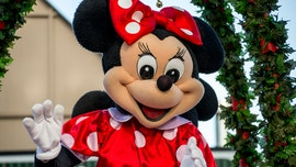 Woman in Minnie Mouse costume filmed brawling with Las Vegas security guard in front of tourists
