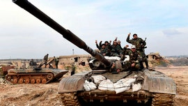 Syrian forces, with Russia's help, capture strategic town from rebels