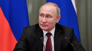 Putin names new Cabinet, keeps foreign, defense, finance ministers
