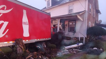 Coca-Cola truck crashes into Pennsylvania home