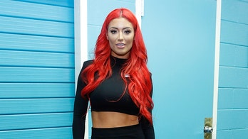 Qantas passenger and former WWE wrestler Eva Marie claims airline's lounge booted her for wearing 'active wear'