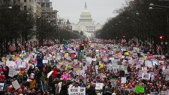National Archives blurs anti-Trump signs in image of 2017 Women's March: report