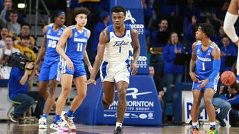 Horne helps lead Tulsa to big upset of No. 20 Memphis